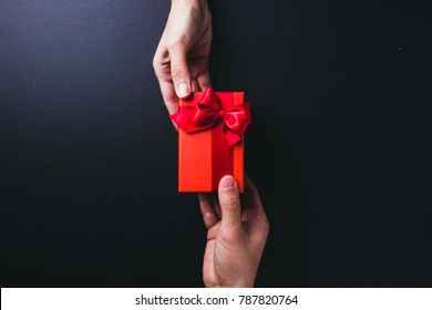 Woman hands receiving package gift box from a man - Valentine Day