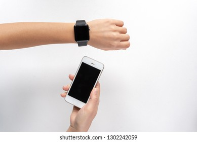 Woman hands with a smartphone and smartwatch with blank screens isolated
