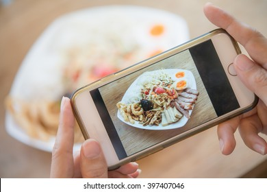 Woman hands taking food photo by mobile phone. Food photography.