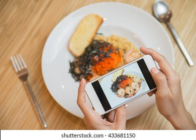 Woman hands taking food photo by mobile phone. Food photography. Share food photography.