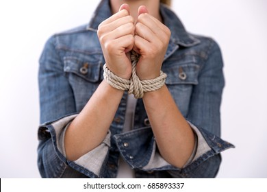 Woman with hands tied in ropes. Problems, difficulties, obstructions and limits in life. Modern slavery