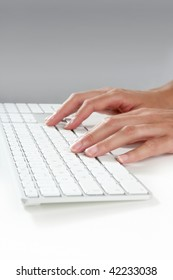 woman hands typing keyboard on desktop