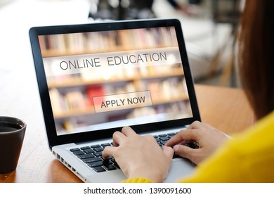Woman hands typing laptop computer with online education on screen background, online learning, education conccept