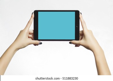 Woman hands using digital tablet. Using for mockup. E-learning concept.