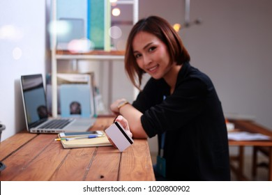Woman hands using tablet, laptop and holding credit card on line shop and Book air ticket  online working shopping online