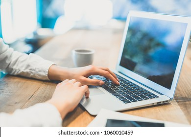 The woman hands work with a modern laptop