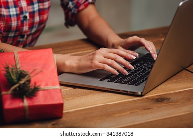 woman hands working with laptop, christmas theme, rustic style