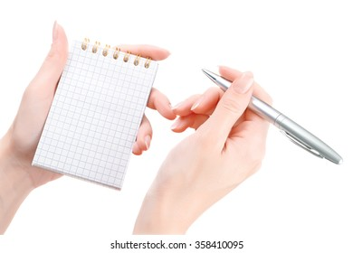 Woman hands writing in empty notepad. Isolated on white