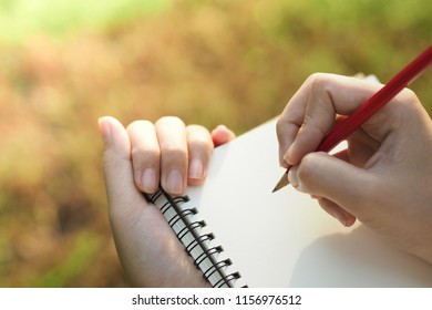 woman hands writing on notebook