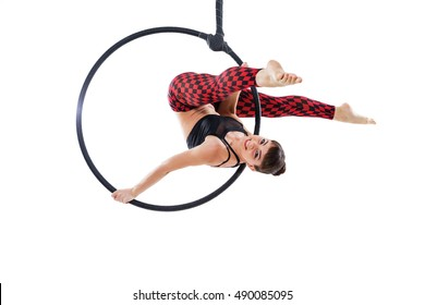 Woman hanging in aerial ring, isolated on white