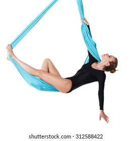 Woman hanging in aerial silk, isolated on white