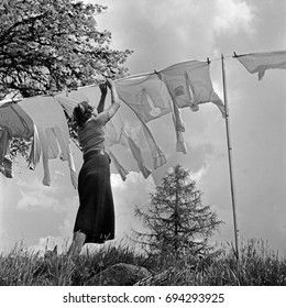 Woman hanging laundry outdoors