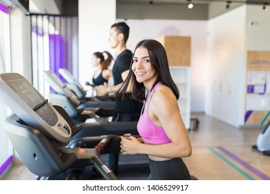 Woman happy about her toned body visiting gym on regular basis