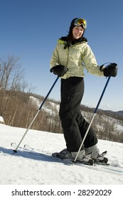 Woman happy to be outside skiing on nice day