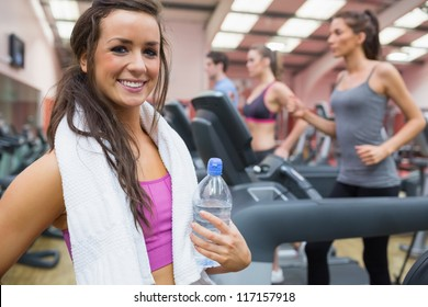 Woman happy in the gym after exercise on the treadmill