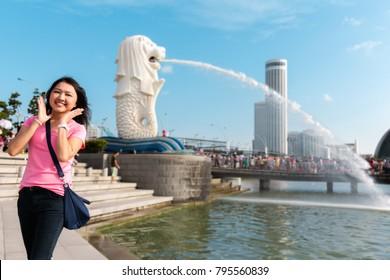 Woman happy on landmark Singapore