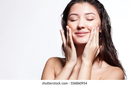 Woman happy to scrub cleanses the skin on a white background isolated