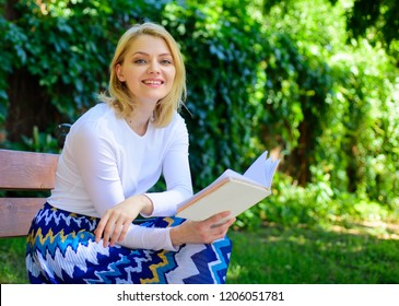 Woman happy smiling blonde take break relaxing in garden reading book. Girl sit bench relaxing with book, green nature background. Lady enjoy self imrovement and education. Improve your knowledge.
