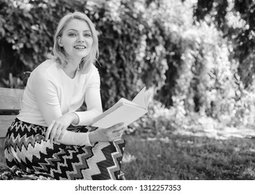 Woman happy smiling blonde take break relaxing in garden reading poetry. Girl sit bench relaxing with book, green nature background. Lady enjoy poetry in garden. Romantic poem. Enjoy rhyme.