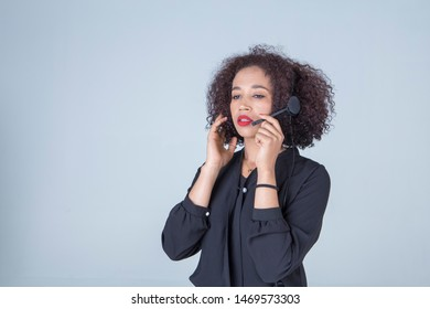 woman happy smiling customer support operator talking with headset in office. communication concept.