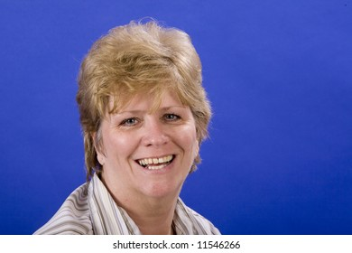 woman happy and smiling on blue background
