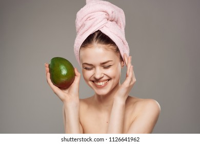woman happy in a towel on her head in a mango hand care for a spa