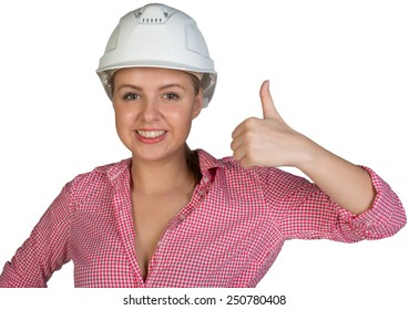 Woman in hard hat showing thumb-up, looking at camera, smiling. Isolated on white background