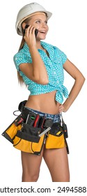 Woman in hard hat and tool belt standing akimbo, calling on mobile phone, looking up. Isolated on white background