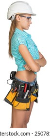 Woman in hard hat, tool belt and protective glasses with her hands crossed on her breast. Isolated on white background