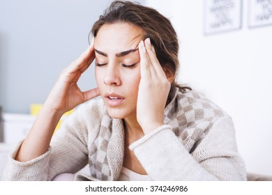 Woman with hard headache holding hands on head