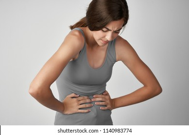 a woman has abdominal pain