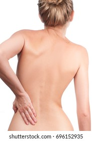Woman has back ache. Picture of woman from the back. Nude shoulders, pain concept.