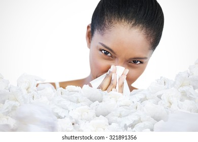 Woman has a cold against used tissues