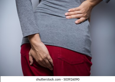 Woman has diarrhea and holding her butt