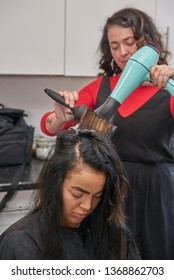 Woman Has Hair Blow Dried by Hair Stylist