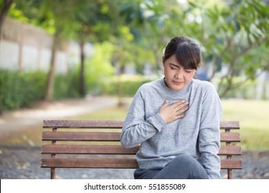 Woman has reflux acids at park