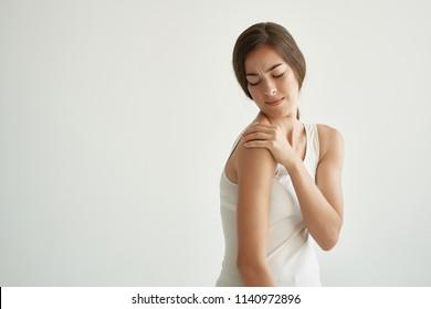 a woman has a shoulder hurt bruise