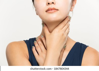 A woman has skincare on her neck.