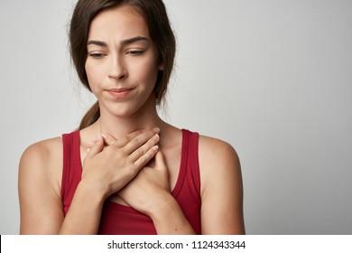 woman has a sore throat