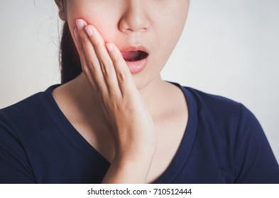 Woman has toothache,Tooth Pain And Dentistry.