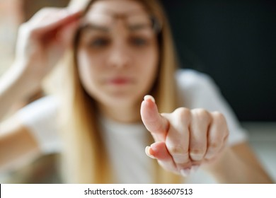 A woman has vision problems, squints when trying to see something, takes off her glasses, is isolated. Myopia, hyperopia, vision concept. High quality photo.