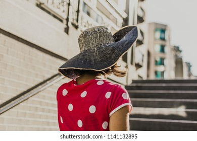 Woman with a hat in the city