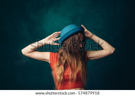 cdf24816fd8 Woman Hat Covering Her Face Hair Stock Photo (Edit Now) 574879918 ...