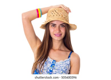 Woman in hat holding hand on her head