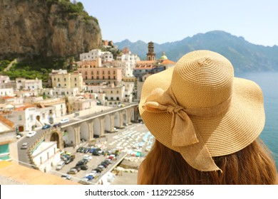 Woman with hat looking at typical italian landscape of Atrani village, Amalfi Coast, Italy