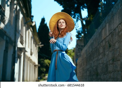 Woman in a hat on the street