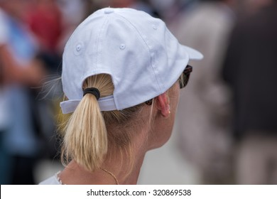 woman with hat and ponytail