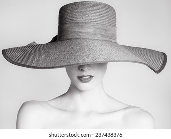 Woman with hat. Studio fashion portrait e2a30a99b4af