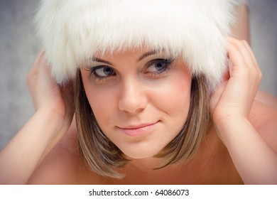 woman in hat from white fur
