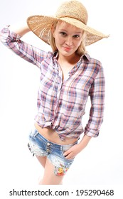 Woman in a hat. Young girl in a straw hat, protect yourself from the sun